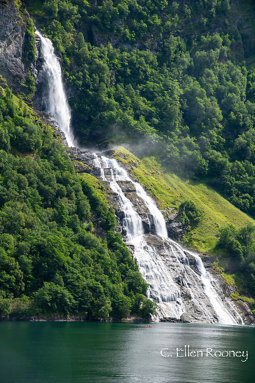 A waterfall tumbling into Geiranger Fjord, Vestlandet, Norway, Europe
