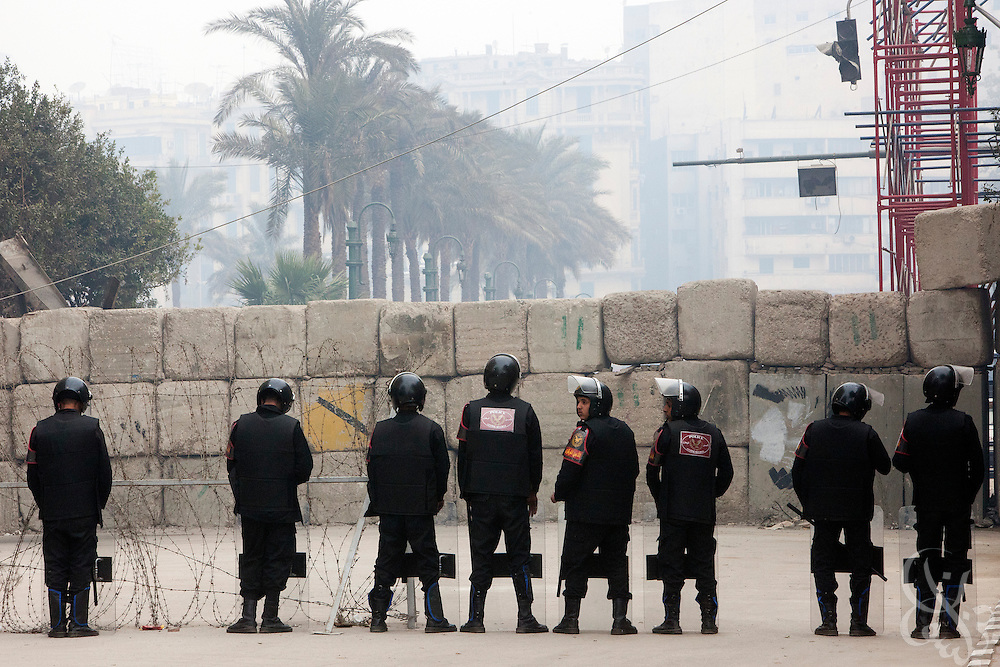 Egyptian riot police stand guard near the parliament complex during the historic first session of Egypt's newly elected Parliament Jan 23, 2012 in Cairo, Egypt.