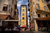 Shoppers and cafegoers flock to the narrow streets of Vieux Nice.