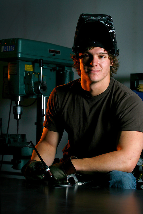 111910-Evergreen, COLORADO-vogel-Evergreen High School senior and metal sculptor Cameron Vogel poses for a portrait inside the metal shop where he grew up watching his father work on cars Friday, November 19, 2010 at his home in Evergreen..Photo By Matthew Jonas/Evergreen Newspapers/Photo Editor