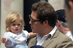 "ARPAD BUSSON partner of Elle Macpherson with their son CY BUSSON at a luncheon hosted by Cartier at the 2004 Goodwood Festival of Speed on 27th June 2004.  Cartier sponsored the ""Style Et Luxe' for vintage cars on the final day of this annual event at Goodwood House, West Sussex."