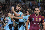 BRISBANE, AUSTRALIA - JULY 09: Aaron Woods of the Blues celebrates with team mates a try by Josh Dugan during game three of the State of Origin series between the Queensland Maroons and the New South Wales Blues at Suncorp Stadium on July 9, 2014 in Brisbane, Australia.  (Photo by Matt Roberts/Getty Images)