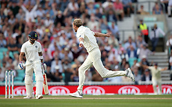 England's Stuart Broad celebrates taking the wicket of India's Virat Kohli during the test match at The Kia Oval, London.