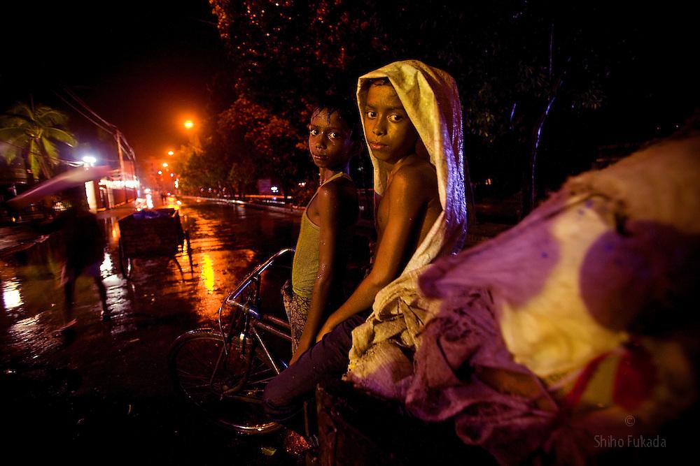 Child van pullers in Dhaka, Bangladesh.