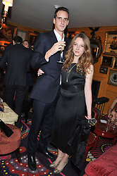 OSCAR BELLVILLE and FLORENCE KEITH-ROACH at a party to celebrate the publication of Tatler Magazine's Little Black Book 2012 held at Annabel's, Berkeley Square, London on 7th November 2012.