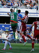 Simon Moore comes to collect the ball in his area during the Sky Bet Championship match between Queens Park Rangers and Cardiff City at the Loftus Road Stadium, London, England on 15 August 2015. Photo by Andy Walter.