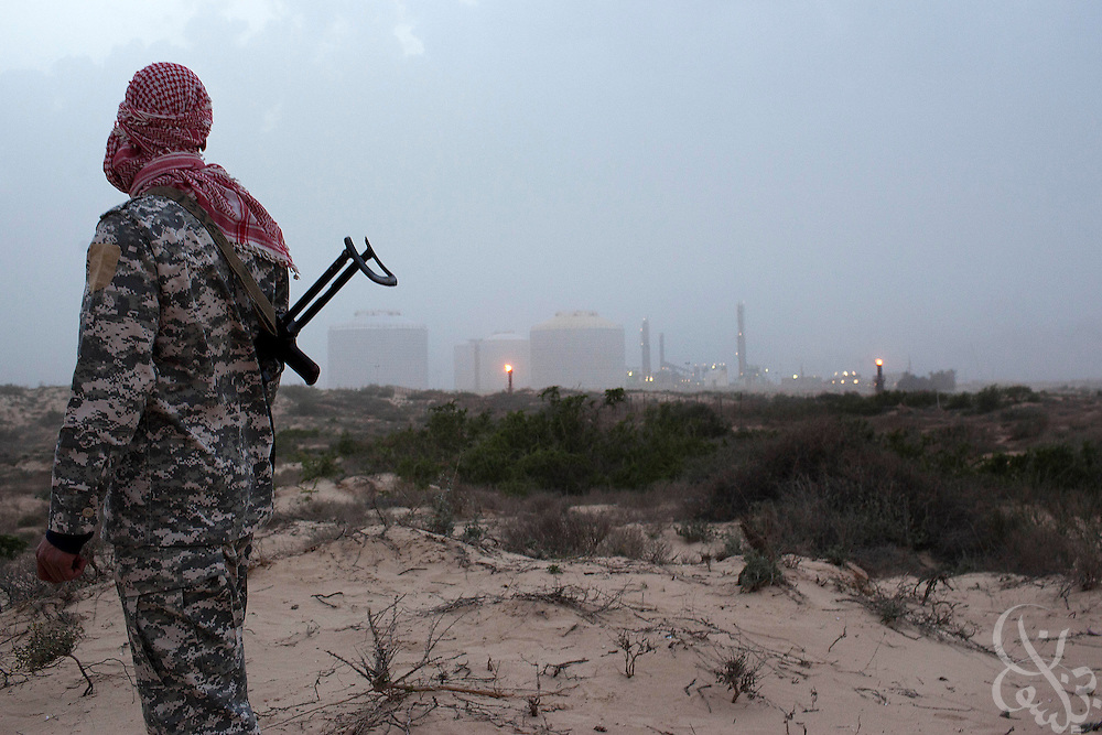An armed Libyan soldier loyal to the opposition stands watch over the Zuwaytinah Oil terminal March 04, 2011 in Zuwaytinah, Libya.  Libyan oil exports have been effected by the uprising and oil prices have risen to new recent highs. .Slug: Libya.Credit: Scott Nelson for the New York Times