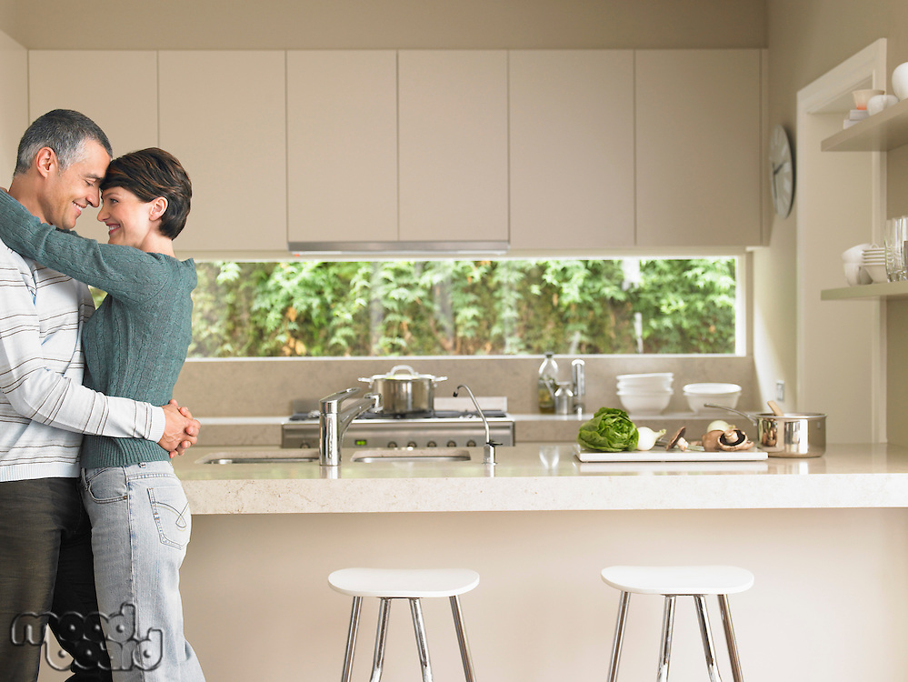 Affectionate Married Couple in Kitchen