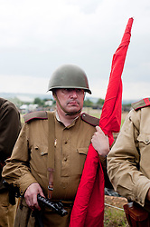 "A Re-enactor portrays a Soviet soldier from the Russian 13th Guards Rifle Division ""Poltavaskaya"" during the ""Spam 1940s Wartime Weekend"" at the Ponderosa in Heckmondwike<br />