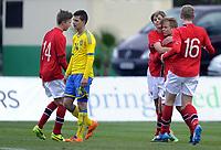Fotball<br /> Landskamp G17<br /> Norge v Sverige / Norway v Sweden 2:1<br /> La Manga Spania <br /> 09.02.2014<br /> Foto: Morten Olsen/Digitalsport<br /> <br /> Norway celebrating 2:0<br /> Goalscorer Martin Samuelsen (11) - Manchester City (3R) together with the first goalscorer Sanders Svendsen (10) - Molde (2R) and Henrik Rørvik Bjørdal (16) - Aalesund and Eirik Haugan (14) - Molde