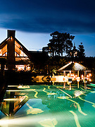 Night view of pool and the Elephant Bar at Anantara Golden Triangle resort.