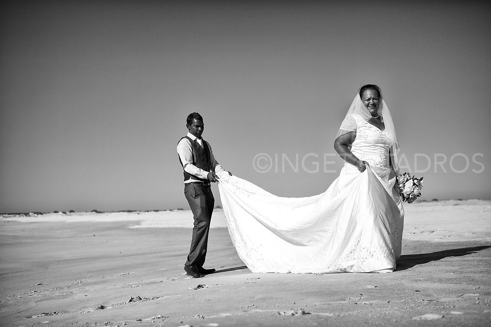Newly wedded couple Dominic and Belinda posing in the sand dunes in the Djarindjin community, which  is an Aboriginal community located 170 km north of Broome in the Kimberley Region of Western Australia.