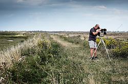 A bird watcher on Wallasea Island. Essex