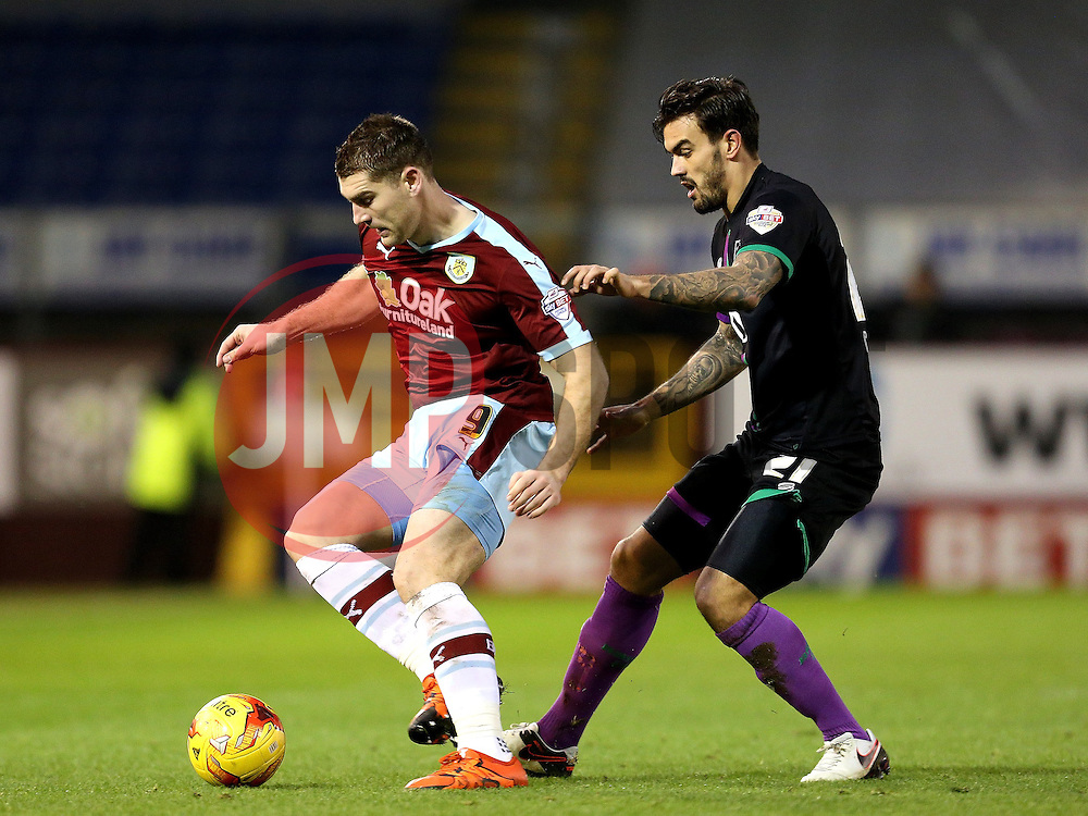 Burnley's Sam Vokes is closed down by Marlon Pack of Bristol City  - Mandatory byline: Matt McNulty/JMP - 07966 386802 - 28/12/2015 - FOOTBALL - Turf Moor - Burnely, England - Burnley v Bristol City - Sky Bet Championship