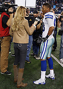 Dallas Cowboys wide receiver Terrance Williams (83) does a postgame television interview with sideline reporter Erin Andrews after the NFL week 18 NFC Wild Card postseason football game against the Detroit Lions on Sunday, Jan. 4, 2015 in Arlington, Texas. The Cowboys won the game 24-20. ©Paul Anthony Spinelli