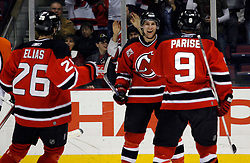 Mar 30, 2007; East Rutherford, NJ, USA; New Jersey Devils center Patrik Elias (26) and New Jersey Devils left wing Zach Parise (9) celebrate after New Jersey Devils center Travis Zajac (19) scores during the second period at Continental Airlines Arena in East Rutherford, NJ.
