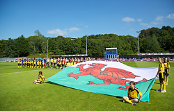 HAVERFORDWEST, WALES - Sunday, August 25, 2013: Wales and France line-up before the Group A match of the UEFA Women's Under-19 Championship Wales 2013 tournament at the Bridge Meadow Stadium. (Pic by David Rawcliffe/Propaganda)