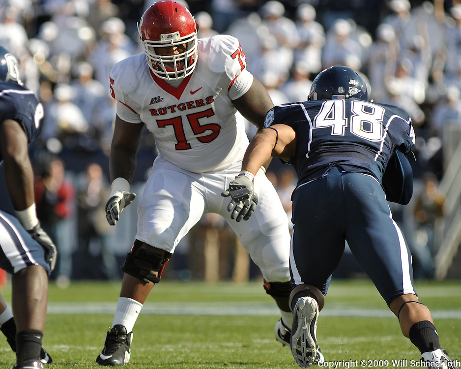 Oct 31, 2009; East Hartford, CT, USA; Rutgers offensive lineman Anthony Davis (75) blocks Connecticut defensive end Trevardo Williams (48) during first half Big East NCAA football action between Rutgers and Connecticut at Rentschler Field.