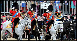 L To R Prince William,Prince Charles, Princess Anne attend the Queen's Trooping of the Colour, The Queen's Birthday Parade, on Horse Guards Parade, Saturday June 16, 2012. Photo by Andrew Parsons/i-Images..All Rights Reserved ©Andrew Parsons/i-Images .See Special Instructions