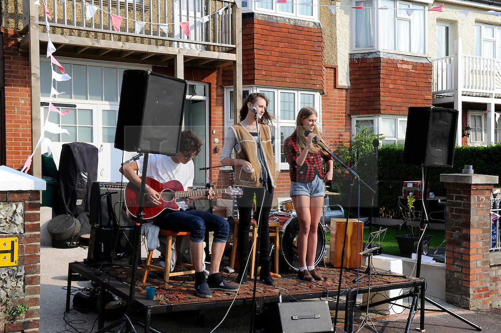 Brighton, UK. 29/04/2011. The Royal Wedding of HRH Prince William to Kate Middleton. A local band plays at a street party in Queens Park Brighton for the Royal Wedding. Photo credit should read: Peter Webb/LNP. Please see special instructions for licensing information. © under license to London News Pictures