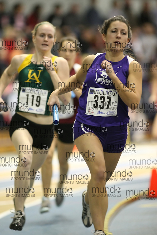 Windsor, Ontario ---13/03/09--- Jen Ricks of  the University of Western Ontario competes in the 4x800m Relay at the CIS track and field championships in Windsor, Ontario, March 13, 2009..Sean Burges Mundo Sport Images