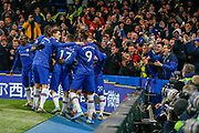 GOAL PENALTY 1-0 Chelsea midfielder Jorginho (5) scores and celebrates in front of Chelsea supporters, fans, and photographers, during the Premier League match between Chelsea and Arsenal at Stamford Bridge, London, England on 21 January 2020.