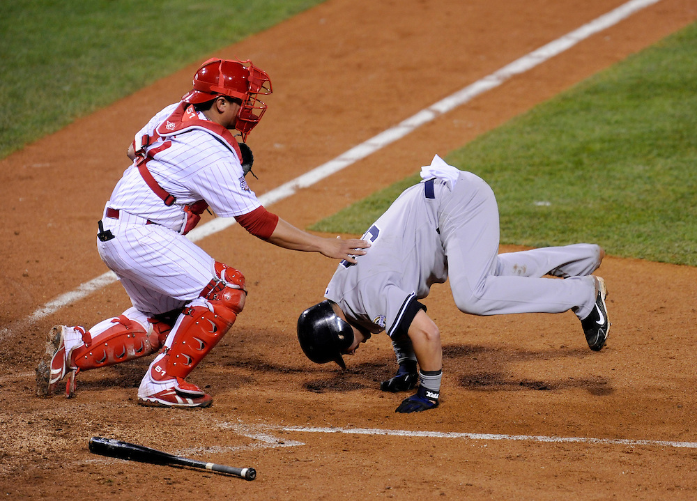PHILADELPHIA - OCTOBER 31: Nick Swisher #33 of the New York Yankees slides safely into home before the tag by Carlos Ruiz #51 of the Philadelphia Phillies in the fifth inning in Game Three of the 2009 MLB World Series at Citizens Bank Park on October 31, 2009 in Philadelphia, Pennsylvania. The Yankees defeated the Phillies 8 to 5.(Photo by Rob Tringali) *** Local Caption *** Nick Swisher;Carlos Ruiz