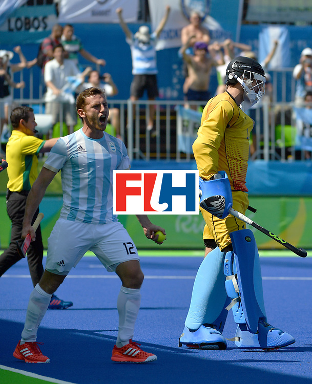 Argentina's Lucas Vila (L) celebrates his teammate Argentina's Gonzalo Peillat's third goal during the men's semifinal field hockey Argentina vs Germany match of the Rio 2016 Olympics Games at the Olympic Hockey Centre in Rio de Janeiro on August 16, 2016. / AFP / Pascal GUYOT        (Photo credit should read PASCAL GUYOT/AFP/Getty Images)