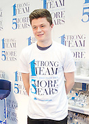 Conservative Party Conference ,<br /> Manchester, Great Britain <br /> 4th October 2015 <br /> <br /> GV shots inside the exhibition area <br /> man wears a t-shirt with current strap line <br /> 1 strong team 5 more years on <br /> <br /> <br /> Photograph by Elliott Franks <br /> Image licensed to Elliott Franks Photography Services