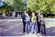 Symond and the Arnolds posing with the police, London, UK, 1980s