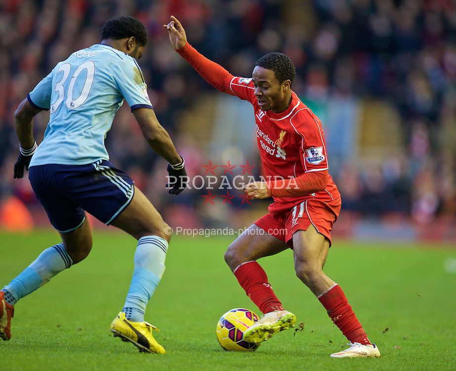 LIVERPOOL, ENGLAND - Saturday, January 31, 2015: Liverpool's Raheem Sterling in action against West Ham United's Alex Song during the Premier League match at Anfield. (Pic by David Rawcliffe/Propaganda)