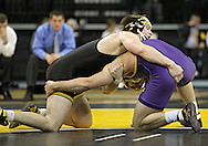 December 8, 2011: Iowa Hawkeyes Grant Gambrall and Northern Iowa Panthers Taylor Kettman in the 197 pound bout of the NCAA wrestling dual between the Northern Iowa Panthers and the Iowa Hawkeyes at Carver-Hawkeye Arena in Iowa CIty, Iowa on Thursday, December 8, 2011. Gambrall defeated Kettman 7-3 and Iowa defeated Northern Iowa 38-4.
