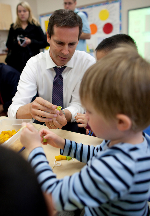 London, Ontario ---10-10-08--- Premier Dalton McGuinty builds necklaces with Cohen Timmins, 4, and Alex You, 4, (hidden) in a full day kindergarten class at Stoney Creek Public School in London, Ontario, October 8, 2010.<br /> GEOFF ROBINS The Globe and Mail