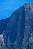 A site seeing helecopter flys above the Kalalau Valley and the Pacific ocean, Kauai, Hawaii, USA.