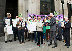 ©under licence to London News Pictures. 18/05/11. London, UK  . Campaigners from Lewisham, Camden & Swindon assemble to protest against the cuts at Department of Culture, Media and Sport, and then delivered a petition to 10 Downing Street. Picture shows Peter Richardson from Lewisham offering a ' Guide to the 1964 Public Libraries and Museums Act' to be delivered to Ed Vaizey, Minister in the Coalition Government with responsibilities for Communication, Culture and the Creative Industries. Please see special instructions for usage rates. Photo credit should read TONY NANDI/LNP