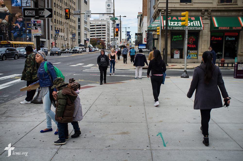 Pedestrians navigate a street in downtown Philadelphia on Monday, Nov. 2, 2015. LCMS Communications/Erik M. Lunsford
