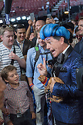 Comedian Stephen Colbert, speaks with House Minority Leader Nancy Pelosi and her grandchildren dressed in costume during the filming of a skit on the floor of the Democratic National Convention July 24, 2016 in Philadelphia, Pennsylvania. Colbert appeared dressed as Caesar Flickerman from the Hunger Games and continues the act from last weeks Republican Convention.