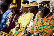 A traditional Fante chief speaks on his cell phone as he sits alongside other chiefs during the annual Oguaa Fetu Afahye Festival in Cape Coast, Ghana on Saturday September 6, 2008.