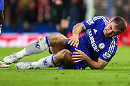 Branislav Ivanovic of Chelsea lays injured on the floor during the Capital One Cup Semi Final 2nd Leg match between Chelsea and Liverpool at Stamford Bridge, London, England on 27 January 2015. Photo by David Horn.