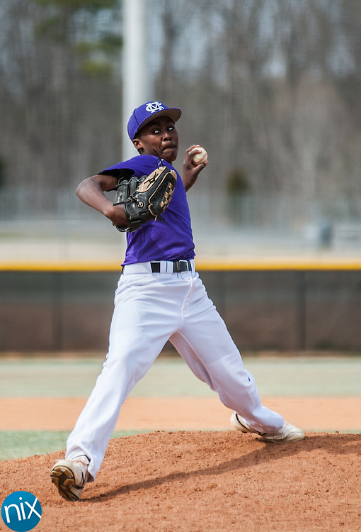 Cox Mill's Julian Smith pitches against First Assembly Christian Wednesday afternoon at Cox Mill High School. Cox Mill won the game 2-1.