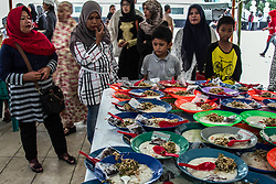 June 2, 2017 - Medan, North Sumatra, Indonesia - Muslim youths wait for a meal to break the fast that is given free to Muslims in a mosque, in Medan on June 2, 2017, North Sumatra Province, Indonesia. More than 1.5 billion Muslims worldwide will mark the month, in which believers do not eat, drink, and smoke from dawn to sunset. (Credit Image: © Ivan Damanik via ZUMA Wire)