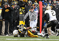 15 NOVEMBER 2008: Iowa wide receiver Derrell Johnson-Koulianos (15) tries to grab his own fumble after a 10 yard reception in the second half of an NCAA college football game against Purdue, at Kinnick Stadium in Iowa City, Iowa on Saturday Nov. 15, 2008. Iowa beat Purdue 22-17.