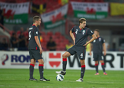 NOVI SAD, SERBIA - Tuesday, September 11, 2012: Wales' David Edwards and Steve Morison look dejected as they kick off after Serbia's second goal during the 2014 FIFA World Cup Brazil Qualifying Group A match at the Karadorde Stadium. (Pic by David Rawcliffe/Propaganda)