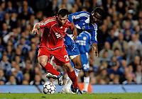 Photo: Richard Lane.<br />Chelsea v Liverpool. UEFA Champions League. Semi Final, 1st Leg. 25/04/2007. <br />Liverpool's Javier Masherano is challenged by Chelsea's John Obi Mikel.