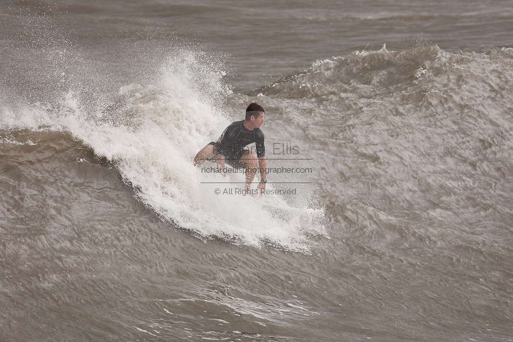 A surfer takes advantage of 14-foot waves churned up by passing Hurricane Irene on August 26, 2011 on Folly Beach, South Carolina. The Charleston area is expected to get only a mild brush with the category 3 hurricane as it heads up the coast.