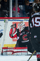 KELOWNA, CANADA - MARCH 14: Taylor Gauthier #35 of the Prince George Cougars makes a third period glove save against the Kelowna Rockets  on March 14, 2018 at Prospera Place in Kelowna, British Columbia, Canada.  (Photo by Marissa Baecker/Shoot the Breeze)  *** Local Caption ***