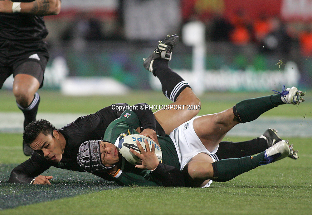 Adrian Jacobs of South Africa off loads the after being tackled by Rudi Wulf of the All Blacks during the Philips Tri Nations, Test match, All Blacks v South Africa, Carisbrook, Dunedin, New Zealand, Saturday 12 July 2008. South Africa won 30 - 28. Photo: Jeff Brass/PHOTOSPORT