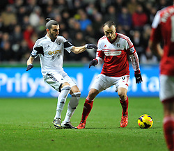 Swansea City's Chico passes the ball away from Fulham's Dimitar Berbatov - Photo mandatory by-line: Alex James/JMP - Tel: Mobile: 07966 386802 28/01/2014 - SPORT - FOOTBALL - Liberty Stadium - Swansea - Swansea City v Fulham - Barclays Premier League