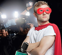 Superhero being photographed by paparazzi