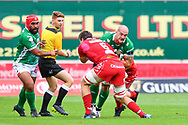 Marco Lazzaroni of Benetton Treviso is tackled by Ed Kennedy of Scarlets<br /> <br /> Photographer Craig Thomas/Replay Images<br /> <br /> Guinness PRO14 Round 3 - Scarlets v Benetton Treviso - Saturday 15th September 2018 - Parc Y Scarlets - Llanelli<br /> <br /> World Copyright &copy; Replay Images . All rights reserved. info@replayimages.co.uk - http://replayimages.co.uk